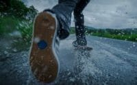 Longboard-in-the-rain-pushing-over-water